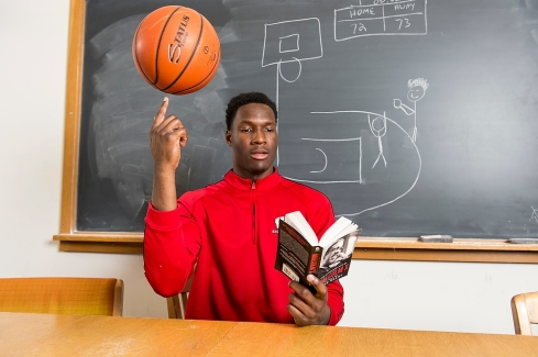 Badger men's basketball player Nigel Hayes is pictured reading a book titled The Autobiography of Malcolm X in the Memorial Library's Greek and Latin Reading Room at the University of Wisconsin-Madison on May 8, 2015. The photo featuring the student-athlete was created for a READ poster for UW-Madison Libraries. (Photo by Jeff Miller/UW-Madison)
